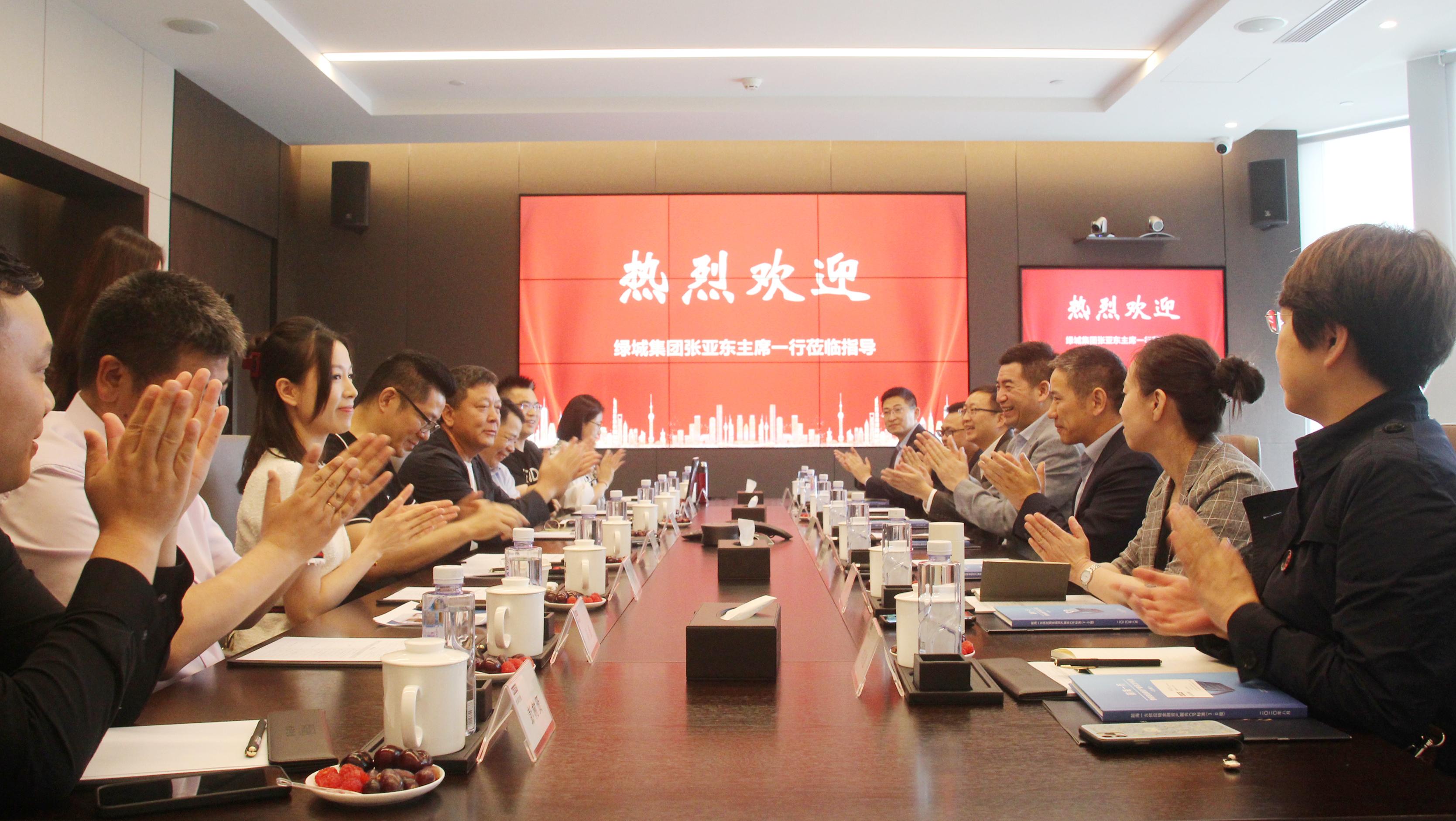 绿城中国董事会主席张亚东一行到访火狐体育官网集团